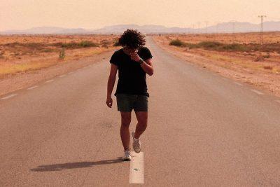 Life Purpose MAN WALKING ON ROAD